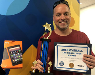"Tim Luz was announced as the ""Overall Biggest User"" for most training hours completed"