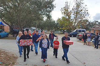 Clermont team Senninger Helping Others delivering gifts for families in need